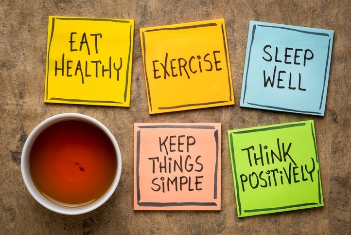 healthy lifestyle reminders on notes with cup of tea