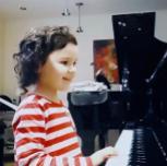 Ananda at piano