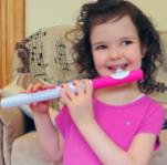 Ananda in pink playing NUVO flute