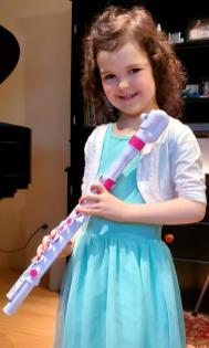 Ananda smiling with plastic flute