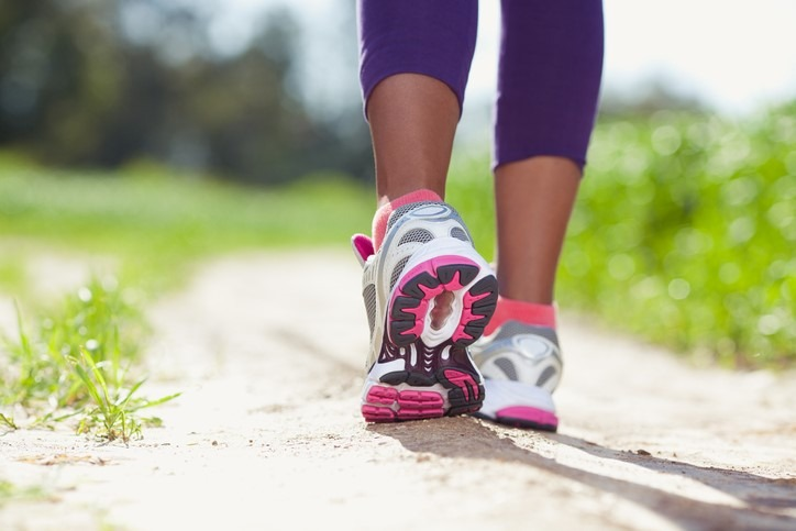 image of runner's feet in sneakers on path