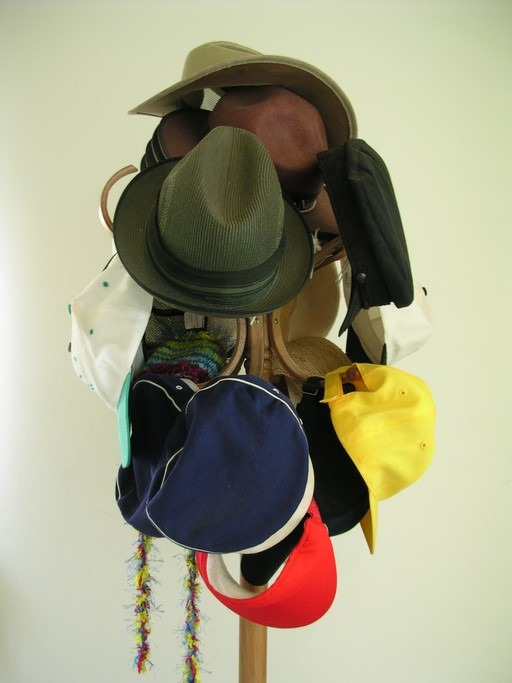 Hat stand holding a variety of different hats