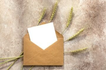 blank letter in envelope with decorative wheat