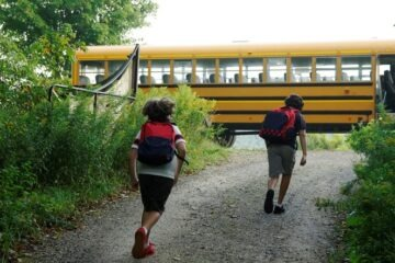 Two boys heading to catch the school bus