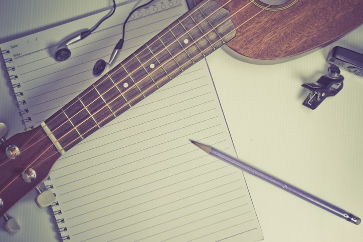 songwriting notebook and pencil ukulele