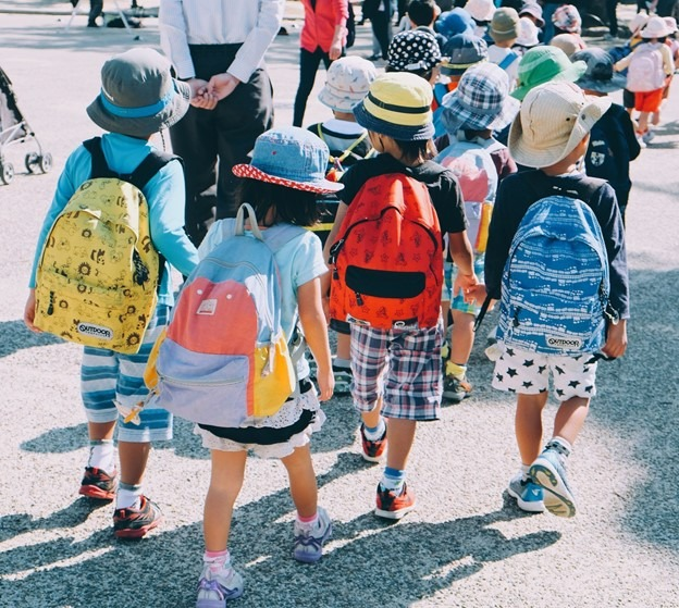 young students walking with backpacks