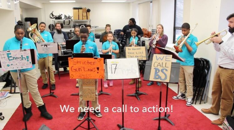 student ensemble We Need a Call to Action